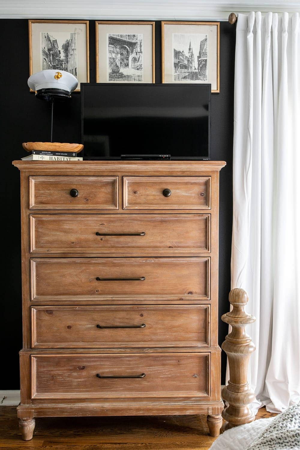 Bedroom TV disguised on dresser top with black paint