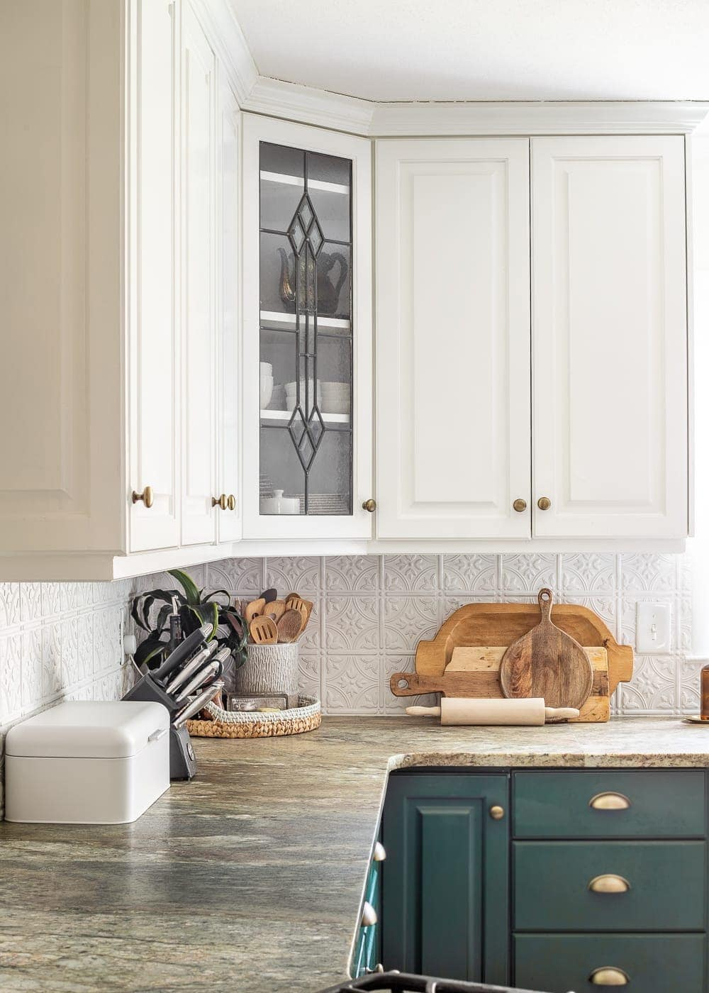 cutting boards, bread box, knife block, and tray to decorate kitchen countertops