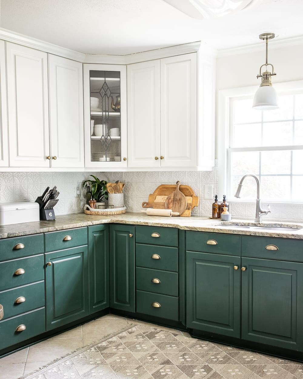 cutting boards, tray, and bread box as kitchen counter decor