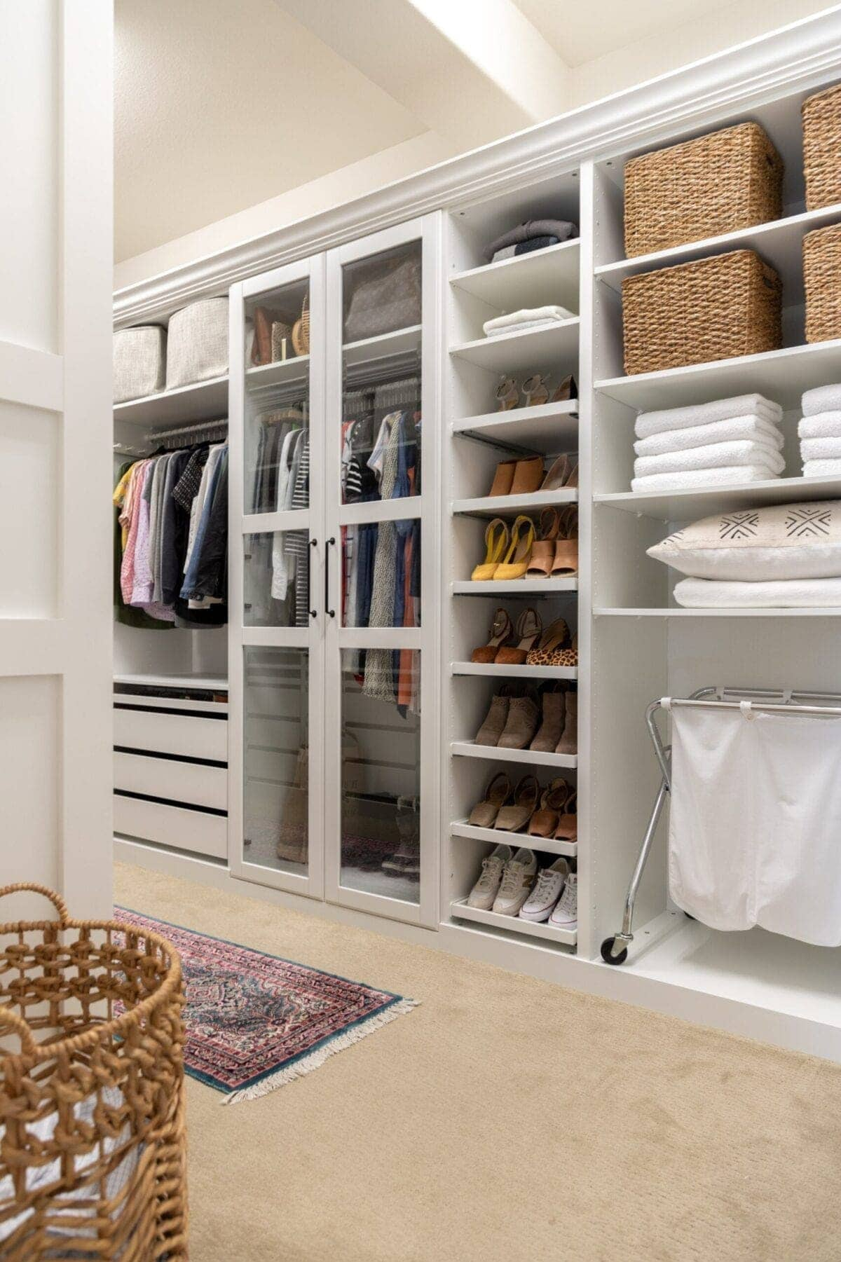IKEA PAX Closet with glass front doors shoe shelves and hamper