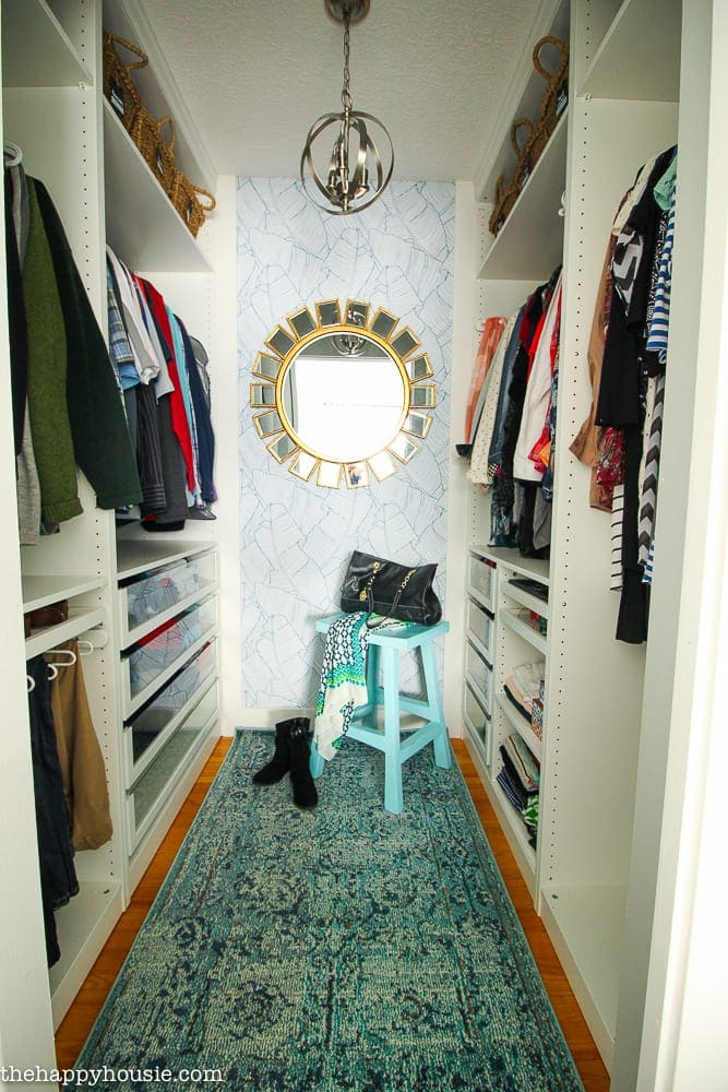IKEA PAX Closet with rug and wallpaper focal wall