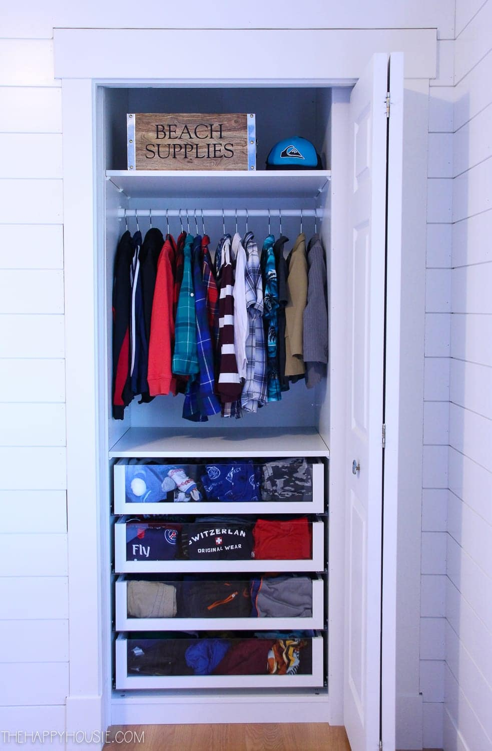 small IKEA PAX Closet with clear drawer fronts