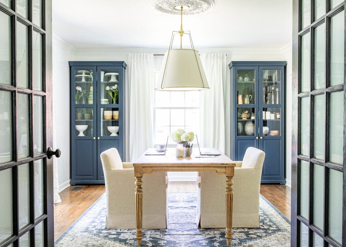 An outdated dining room gets converted to a light and bright home office with a timeless new look and functional storage.
