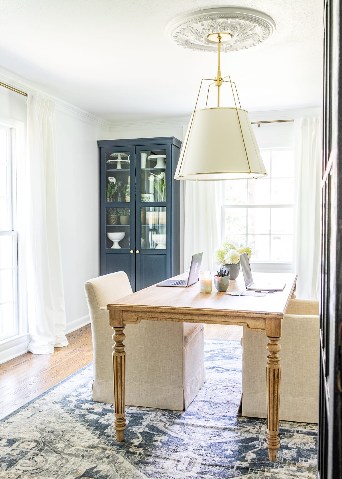 white and navy home office with work table and storage cabinets   Benjamin Moore Hale Navy and Chantilly Lace