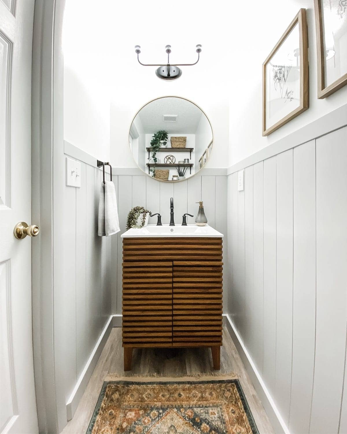 small powder room with vertical shiplap and Mid Century Modern style vanity