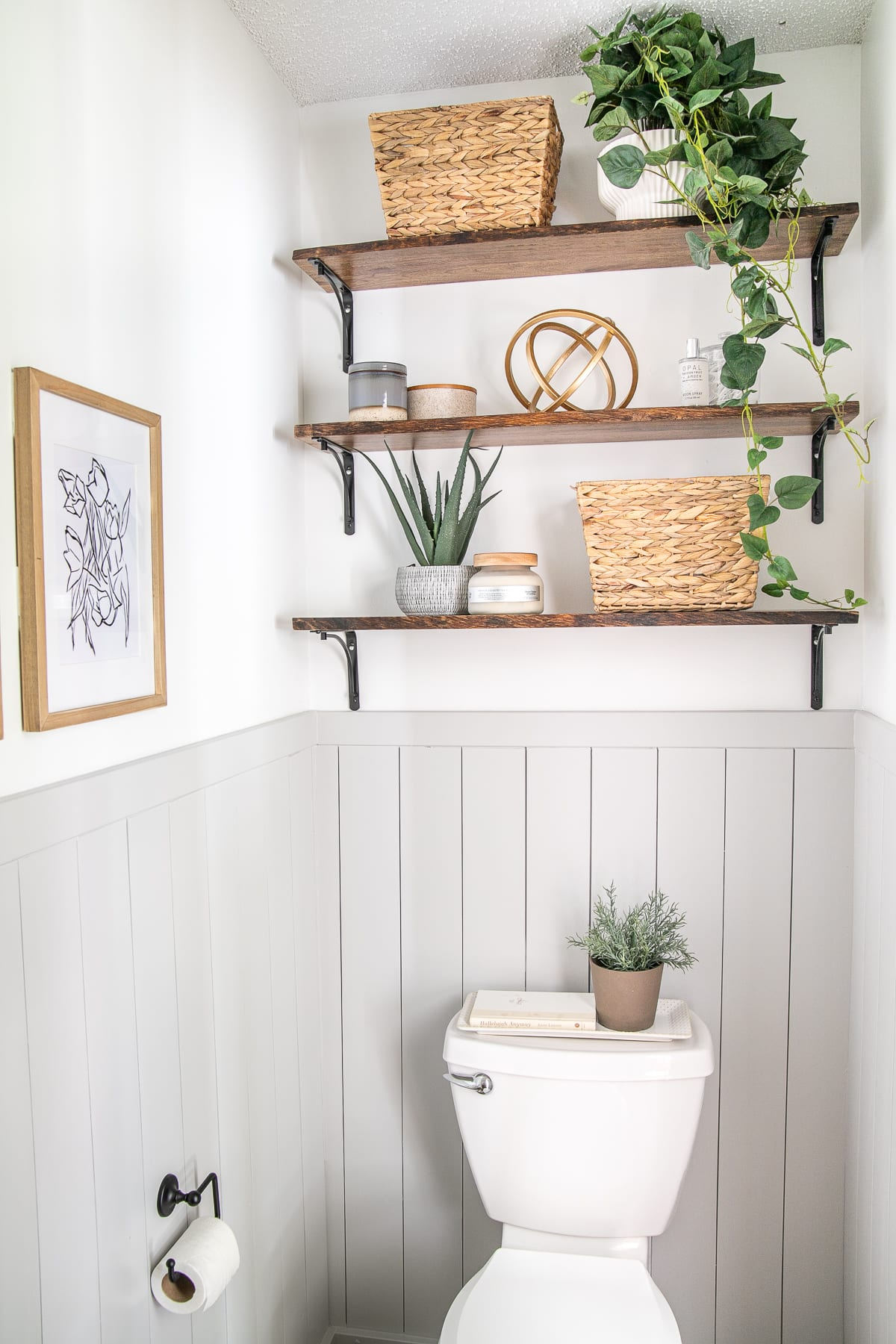 shelves above toilet in small bathroom