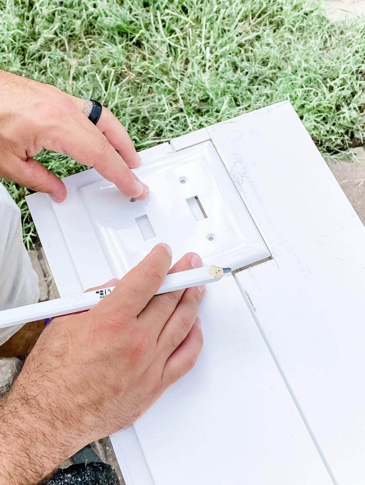 tracing an outlet cover on shiplap boards