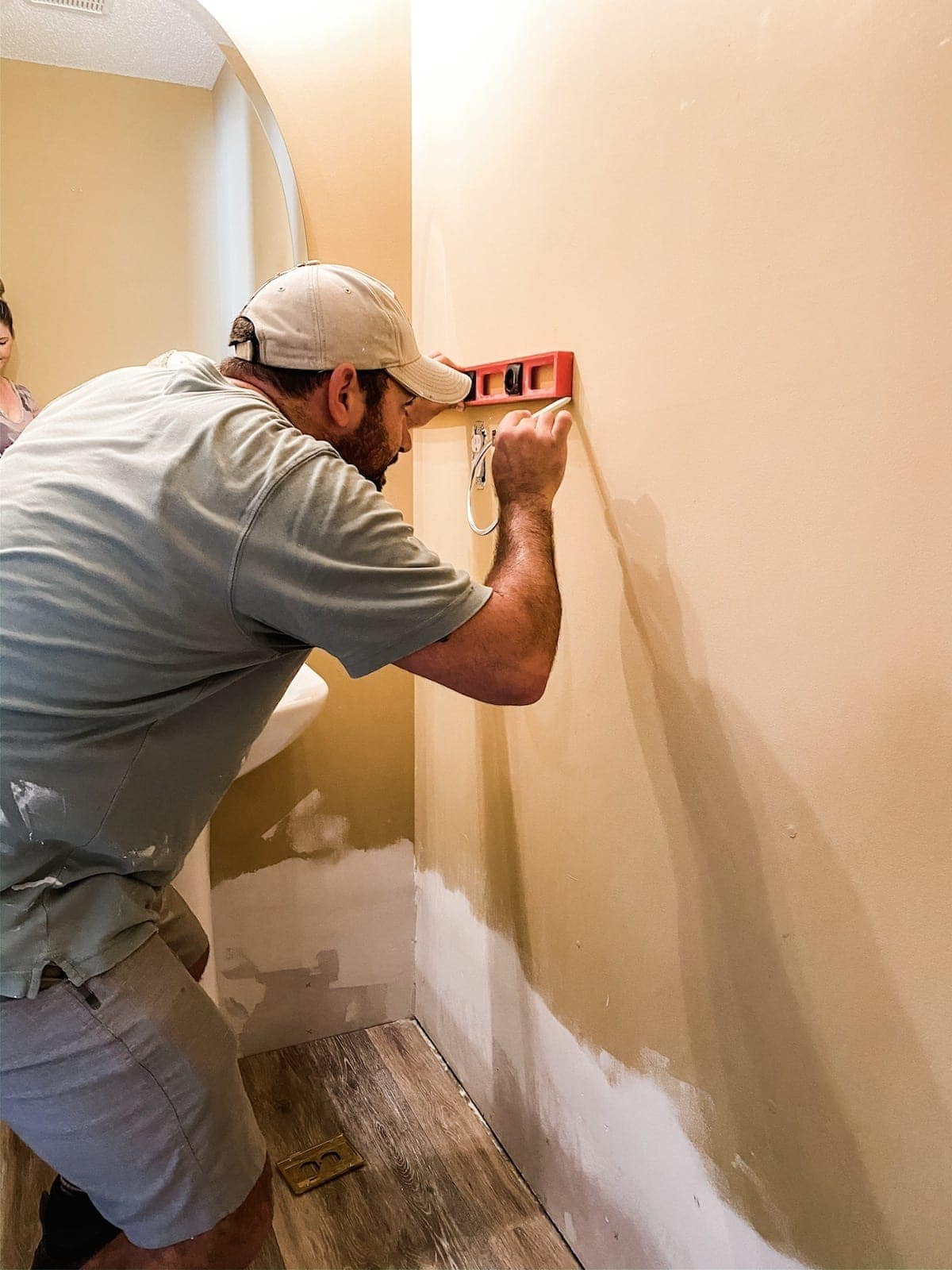 marking a wall with a level for shiplap placement