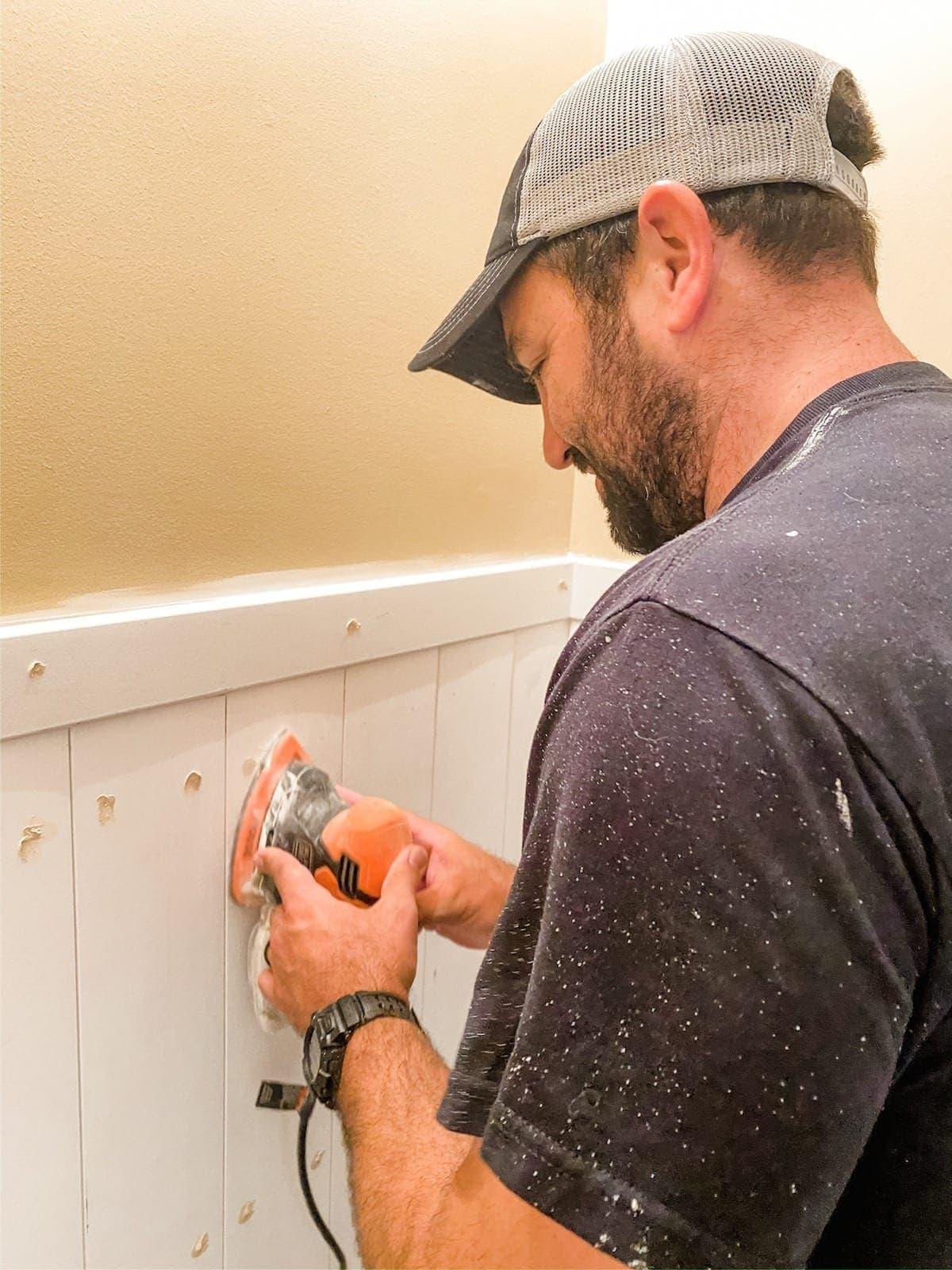 sanding wood filler on wall planks