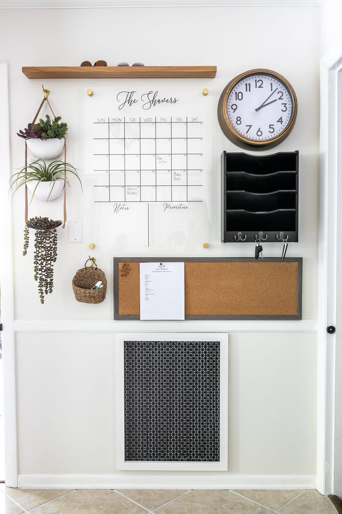 Command center wall with calendar, mail sorter, memo board, and drop zone to keep an entryway clear of clutter.