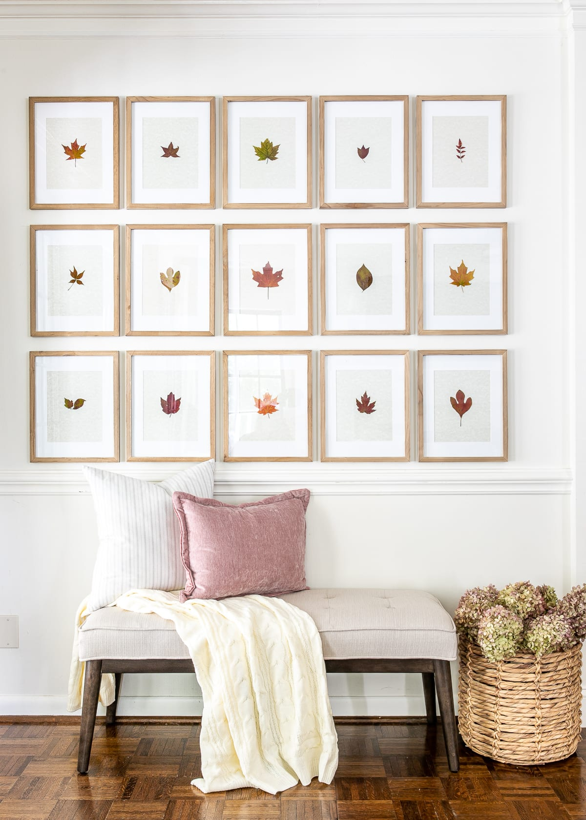 fall entryway with bench and pressed leaf gallery wall