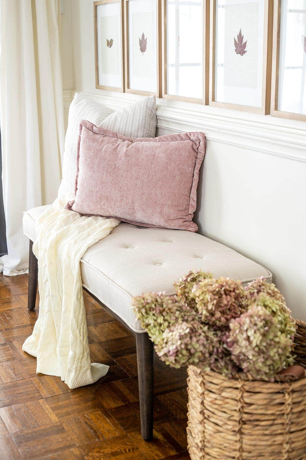 dried hydrangeas entryway bench and blush pillow