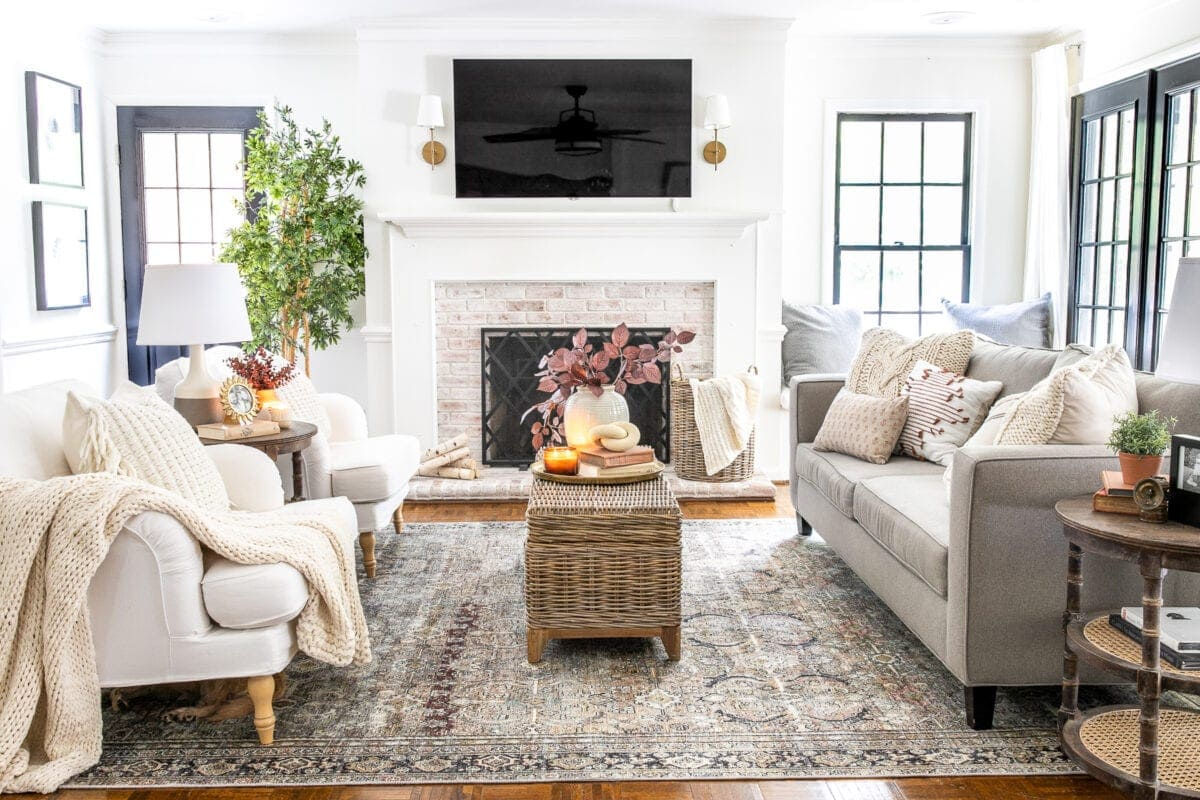 fall living room with tv above fireplace
