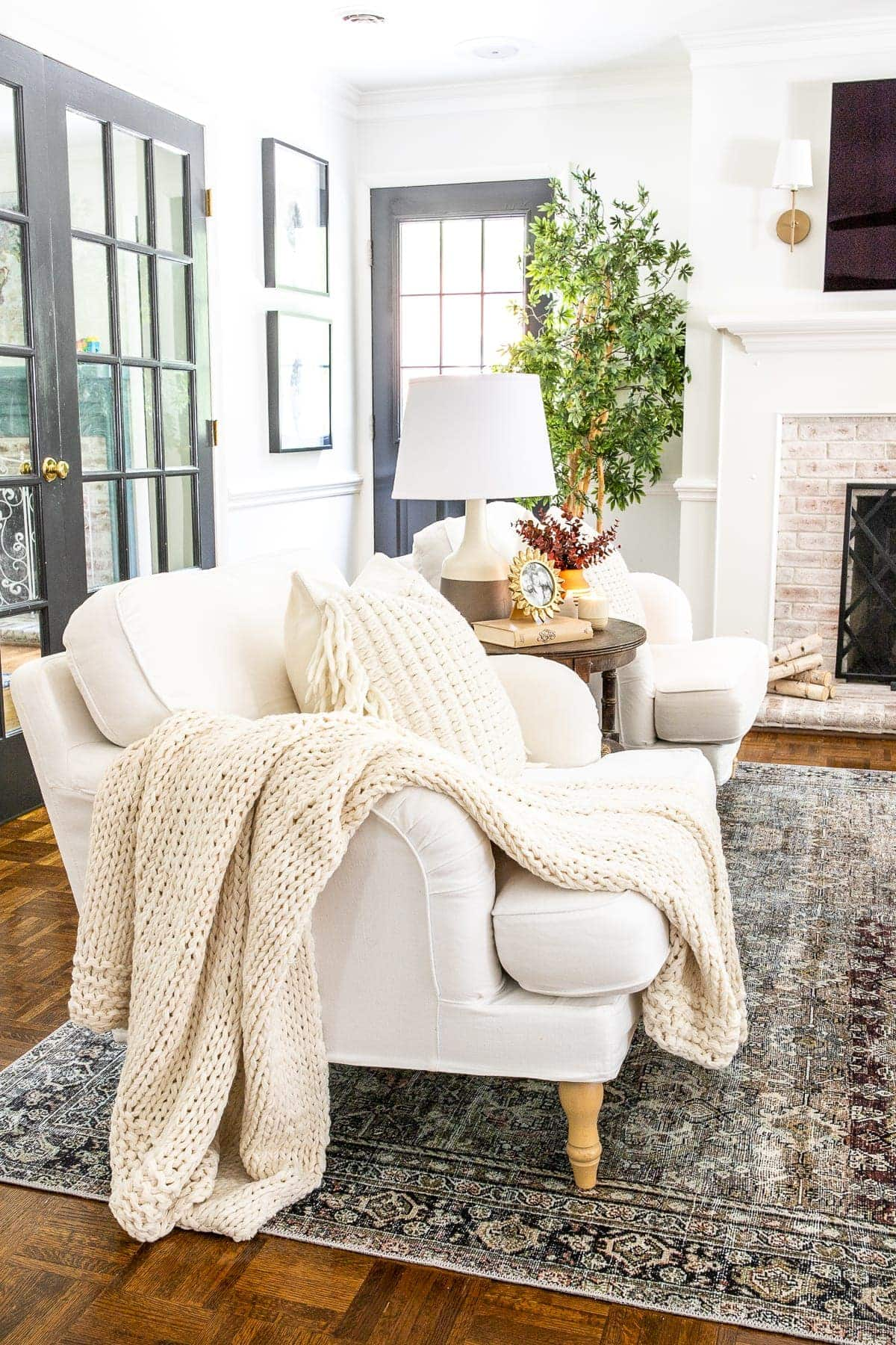 living room accent chairs with cable knit throw blanket and pillows