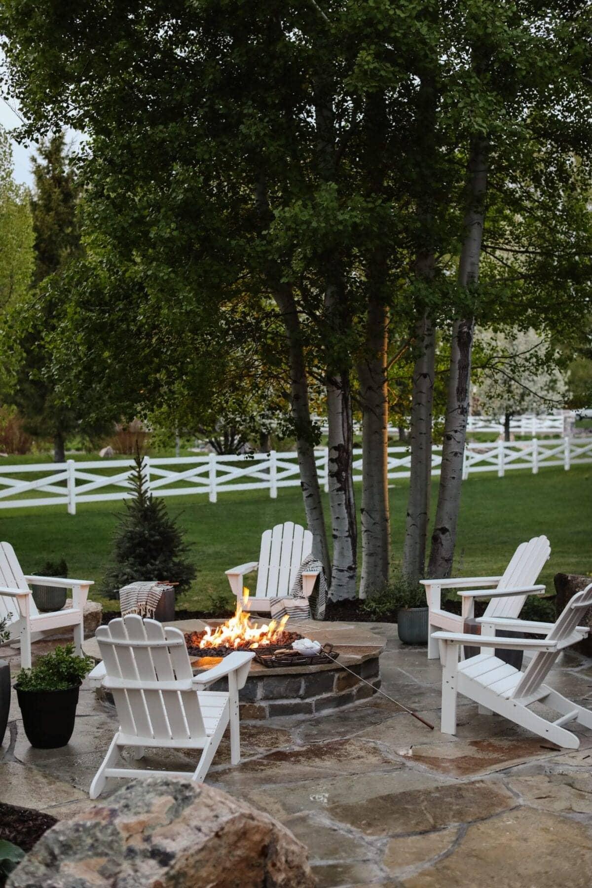 backyard fire pit with adirondack chairs