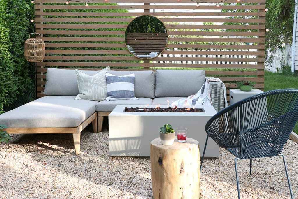 fire pit with sectional and wood screen