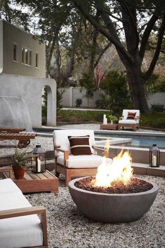 backyard fire pit with pea gravel