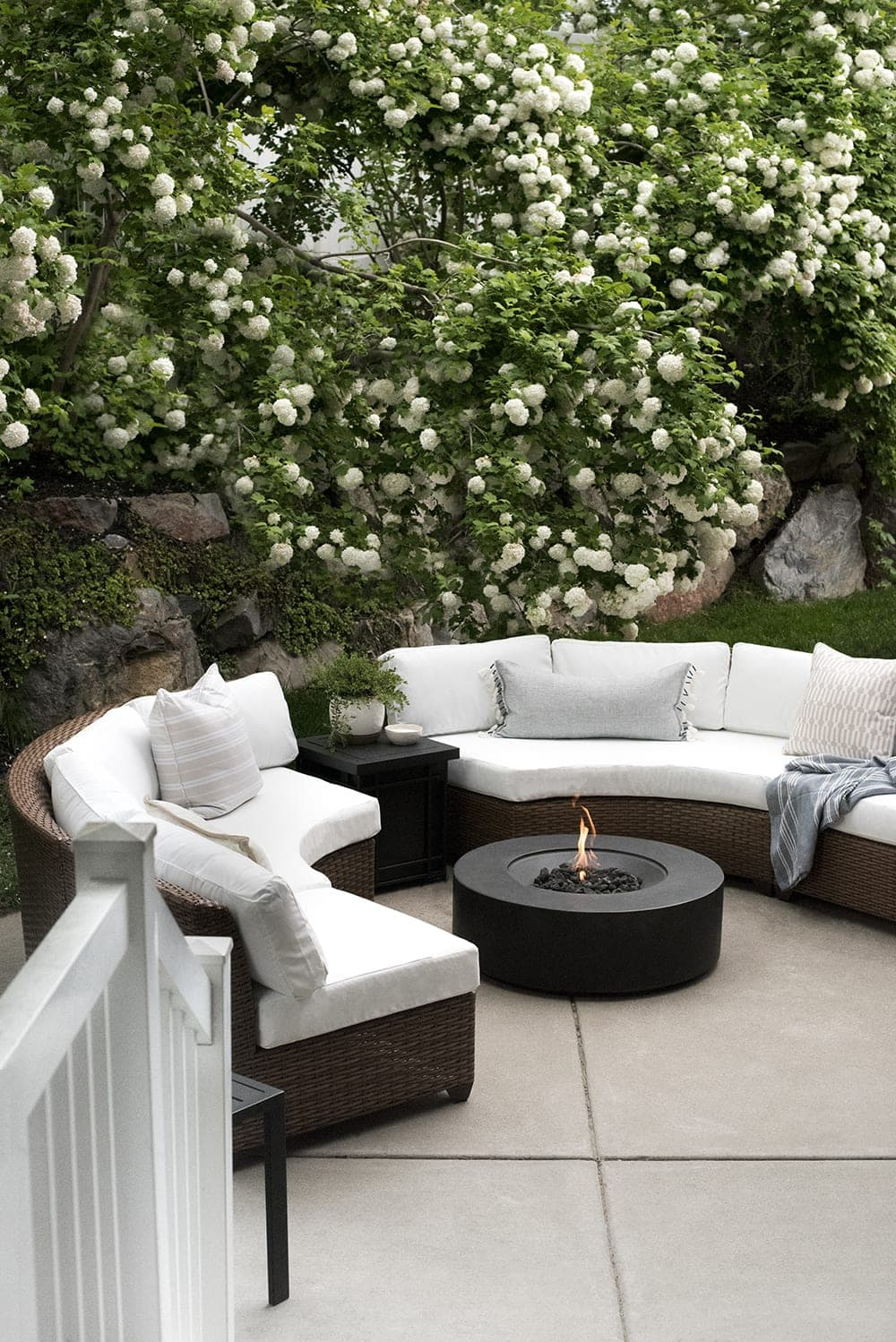back patio fire pit with curved sectionals