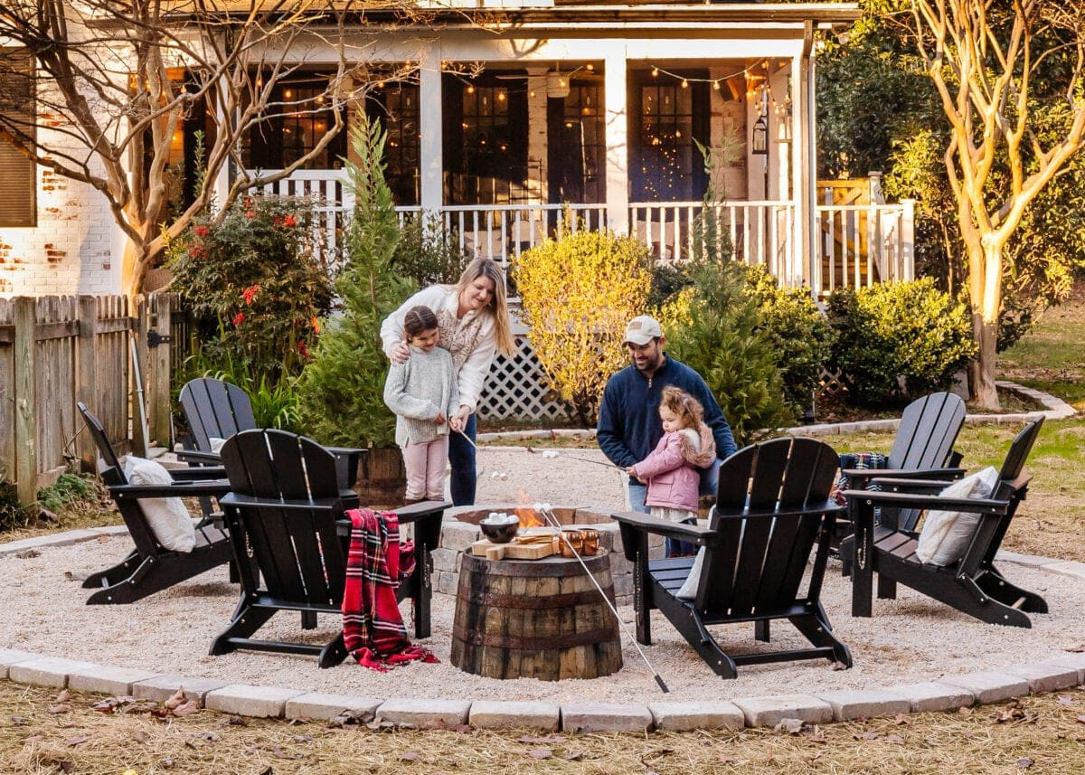 diy fire pit with pea gravel and adirondack chairs