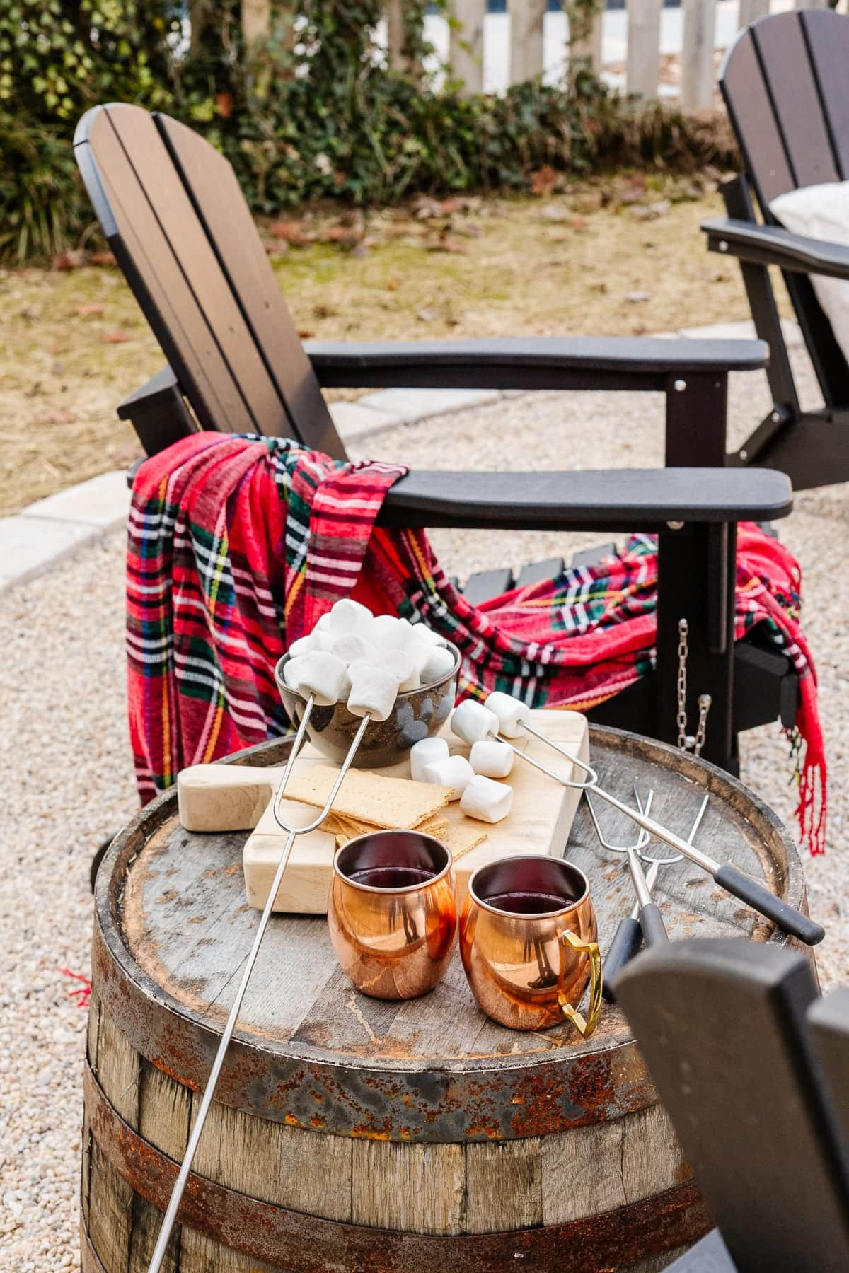 Adirondack chair with barrel side table and s'mores ingredients