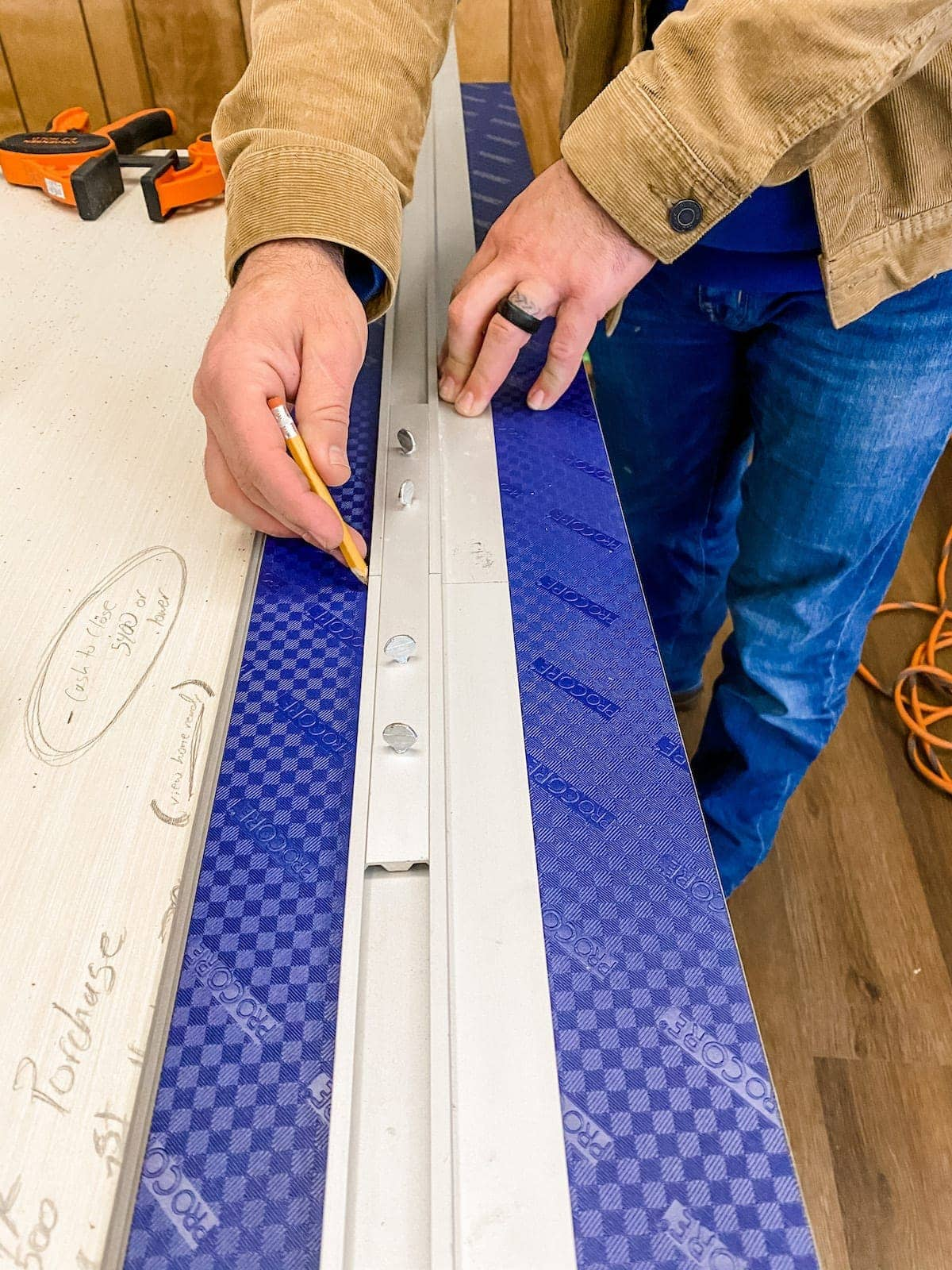 Using a straight edge to cut luxury vinyl plank flooring
