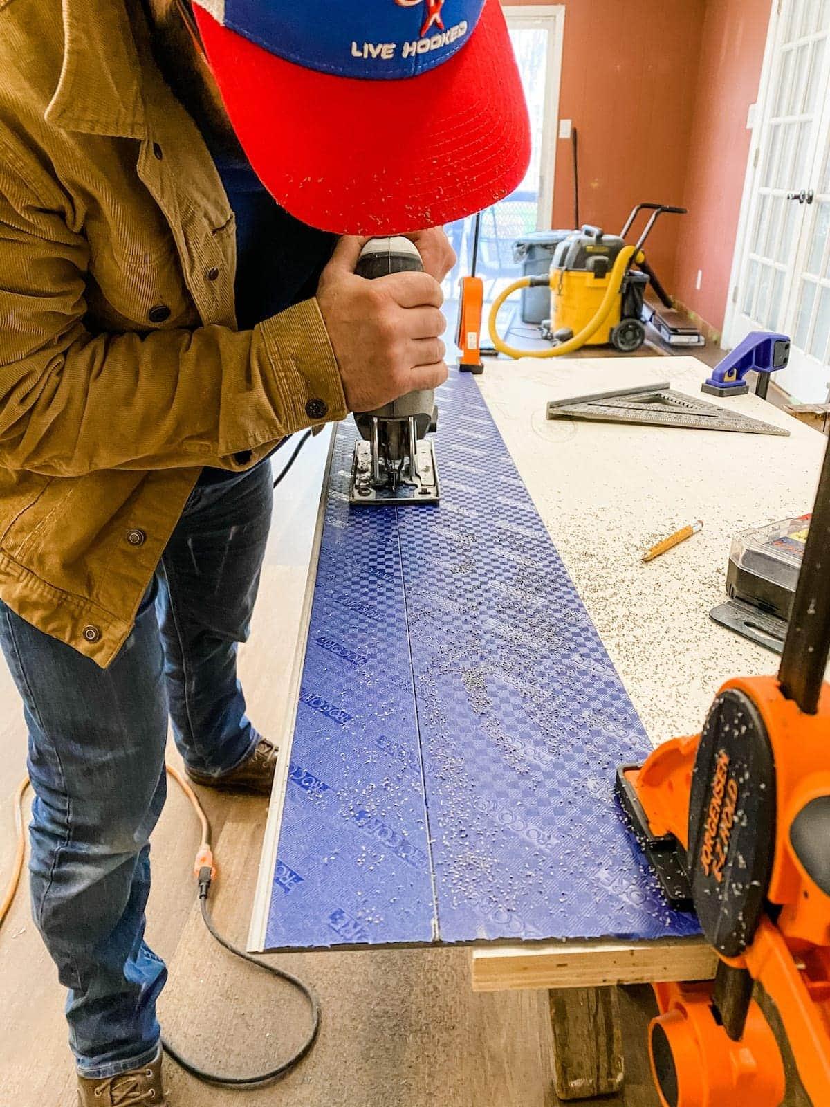 using a jigsaw to cut luxury vinyl plank flooring