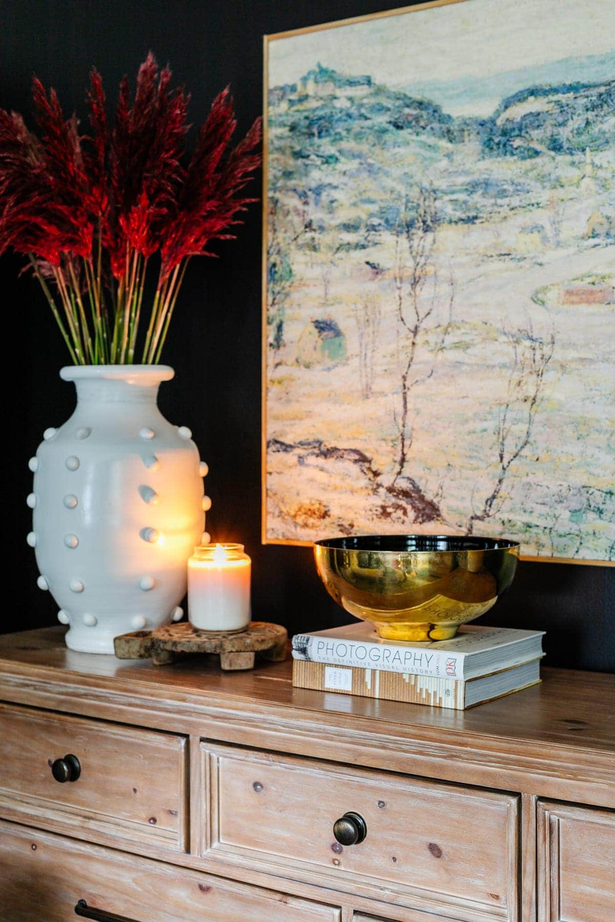 coffee table books styled on a bedroom dresser