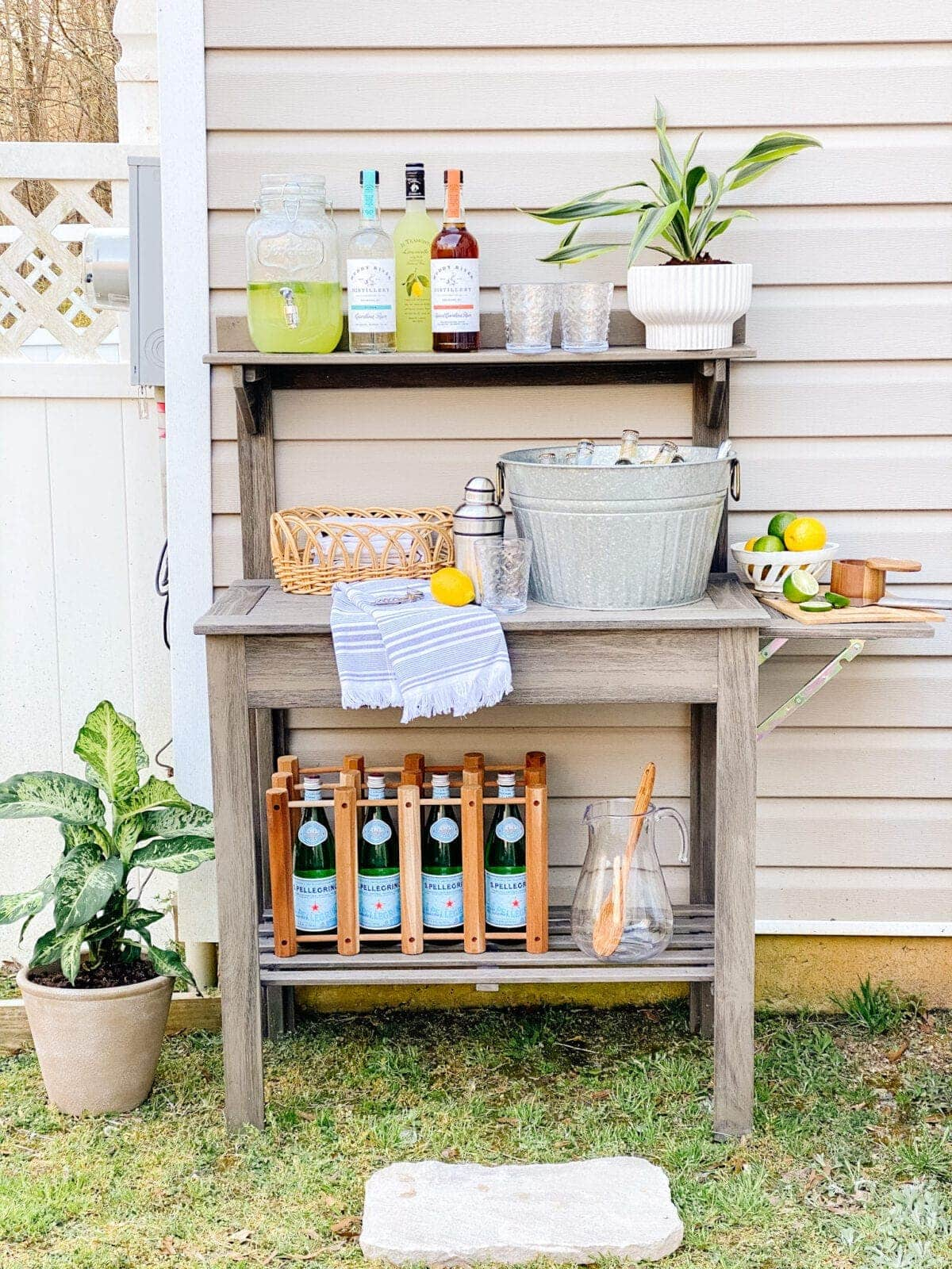 things to buy while thrift shopping : buckets and baskets pictured on outdoor bar
