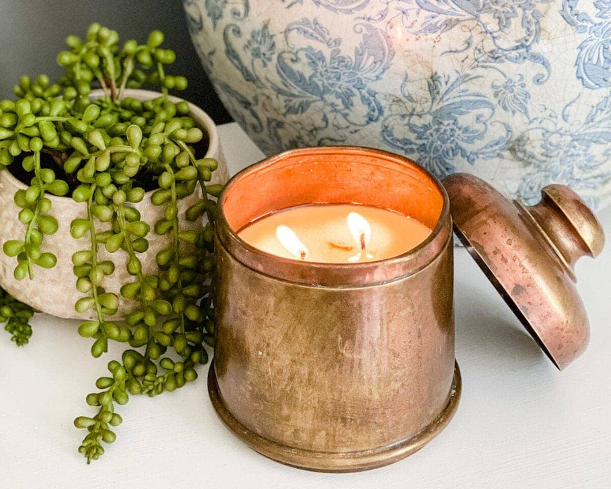 candle made from a thrifted antique brass canister