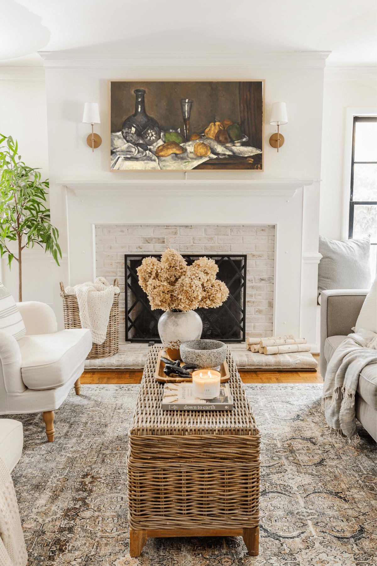 Samsung Frame TV in living room with still life art
