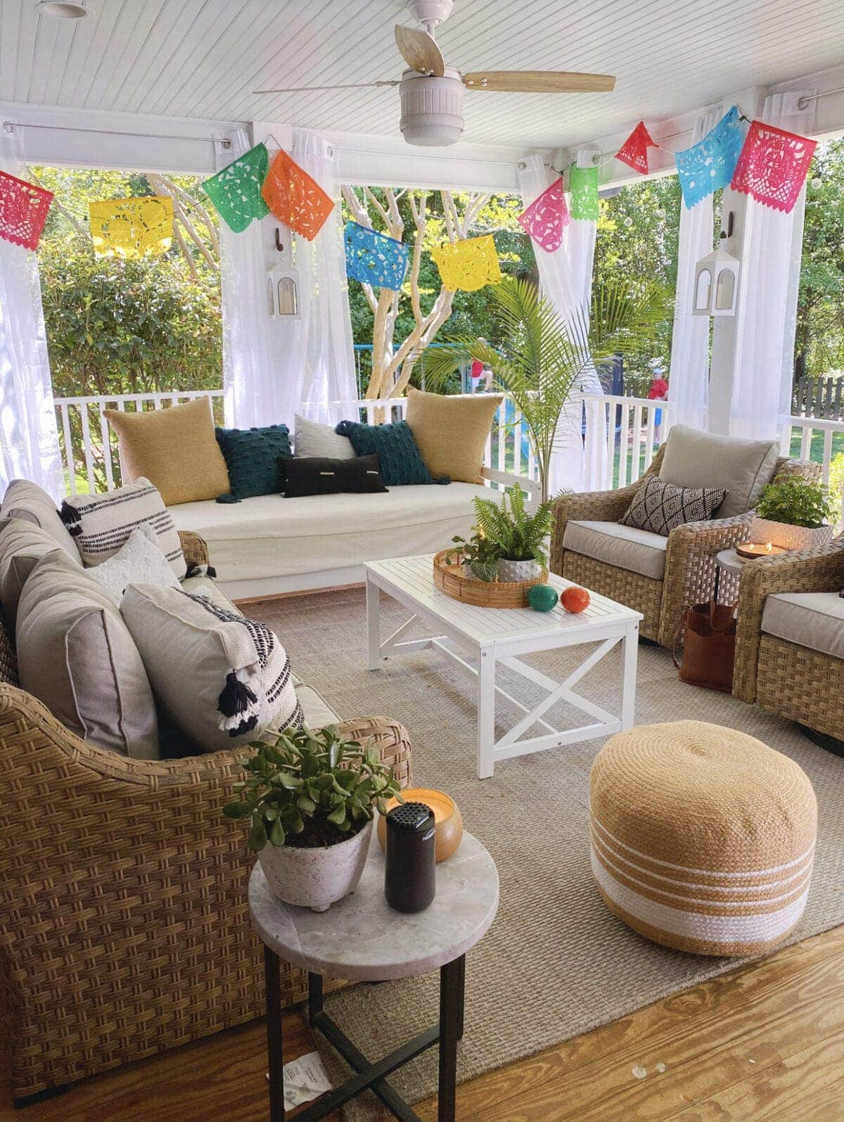 Colorful Mexican banners around back porch sitting area