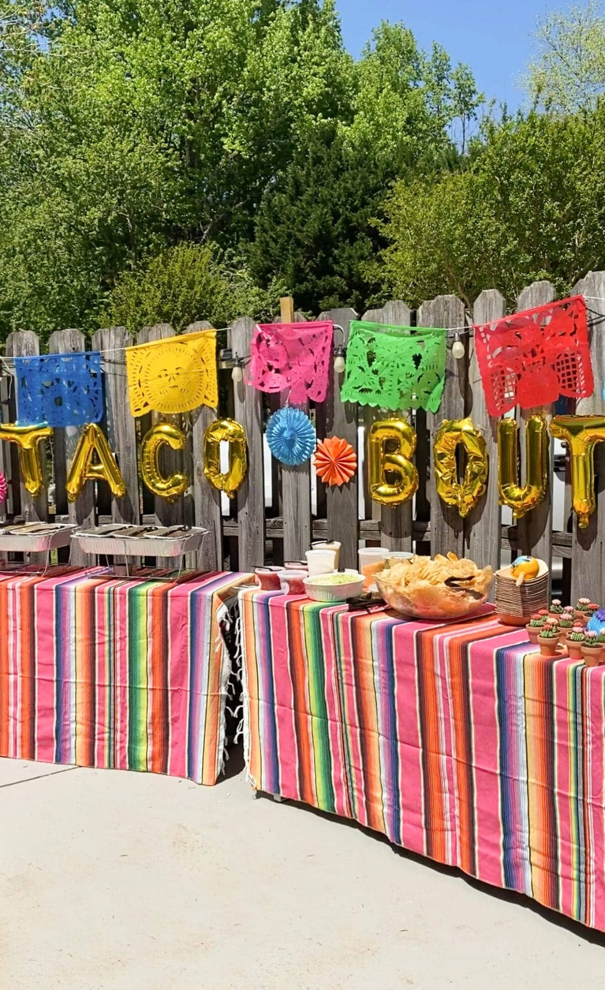 baby shower taco bar decorated with Mexican serape tablecloths, banners, and Taco Bout a Baby balloons