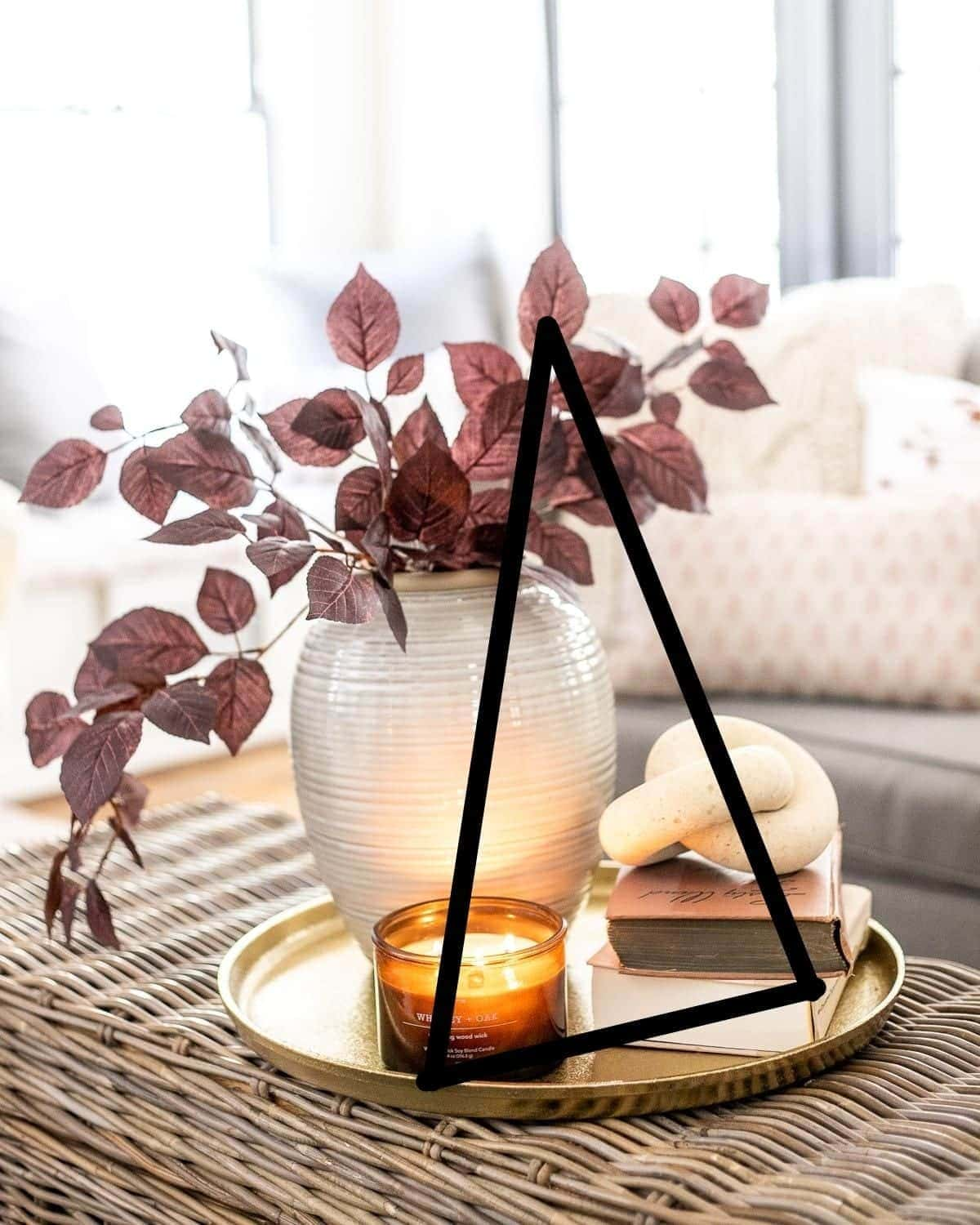the decorator's triangle on a coffee table vignette