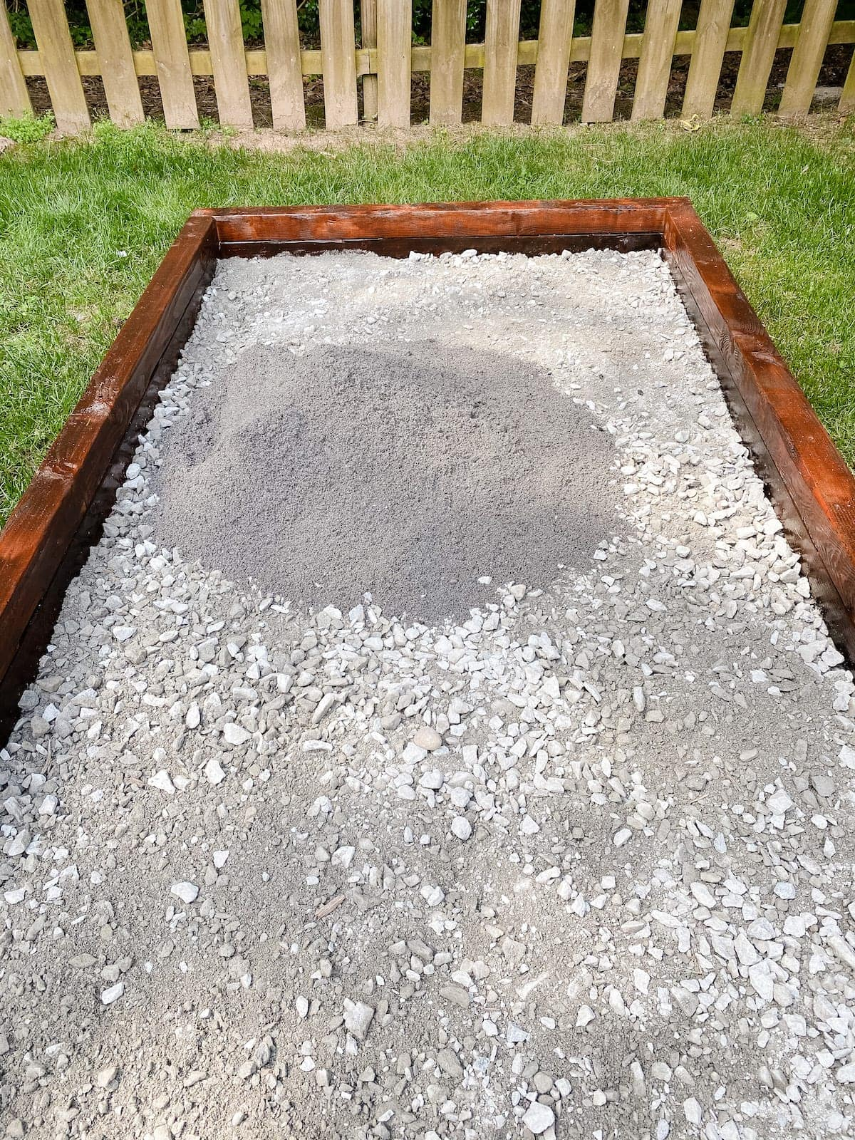 spreading screen washing and paver base for bocce ball court