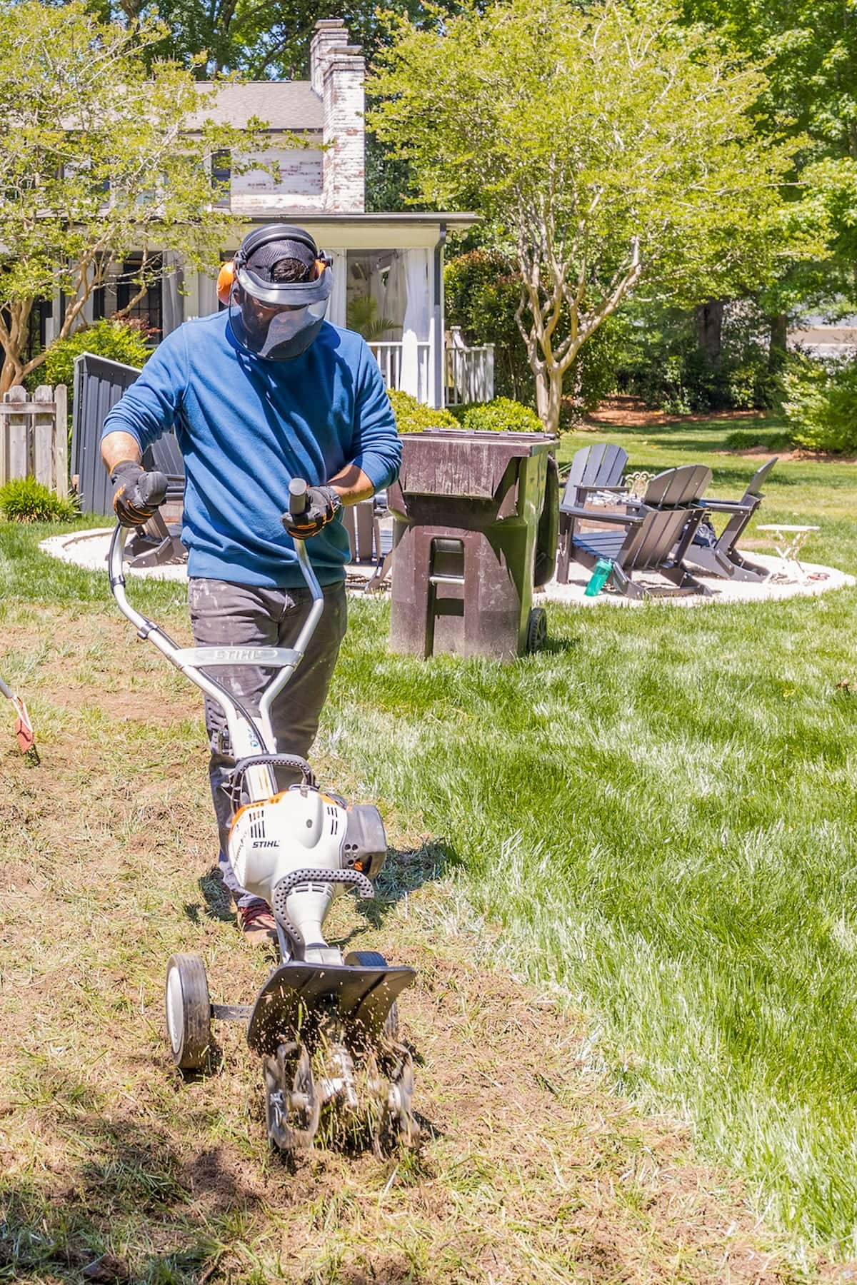 cultivating soil with a STIHL Yard Boss