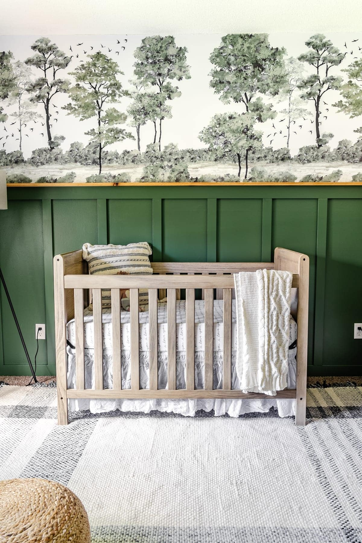 baby boy nursery idea with woodland theme using green paint and peel & stick tree mural