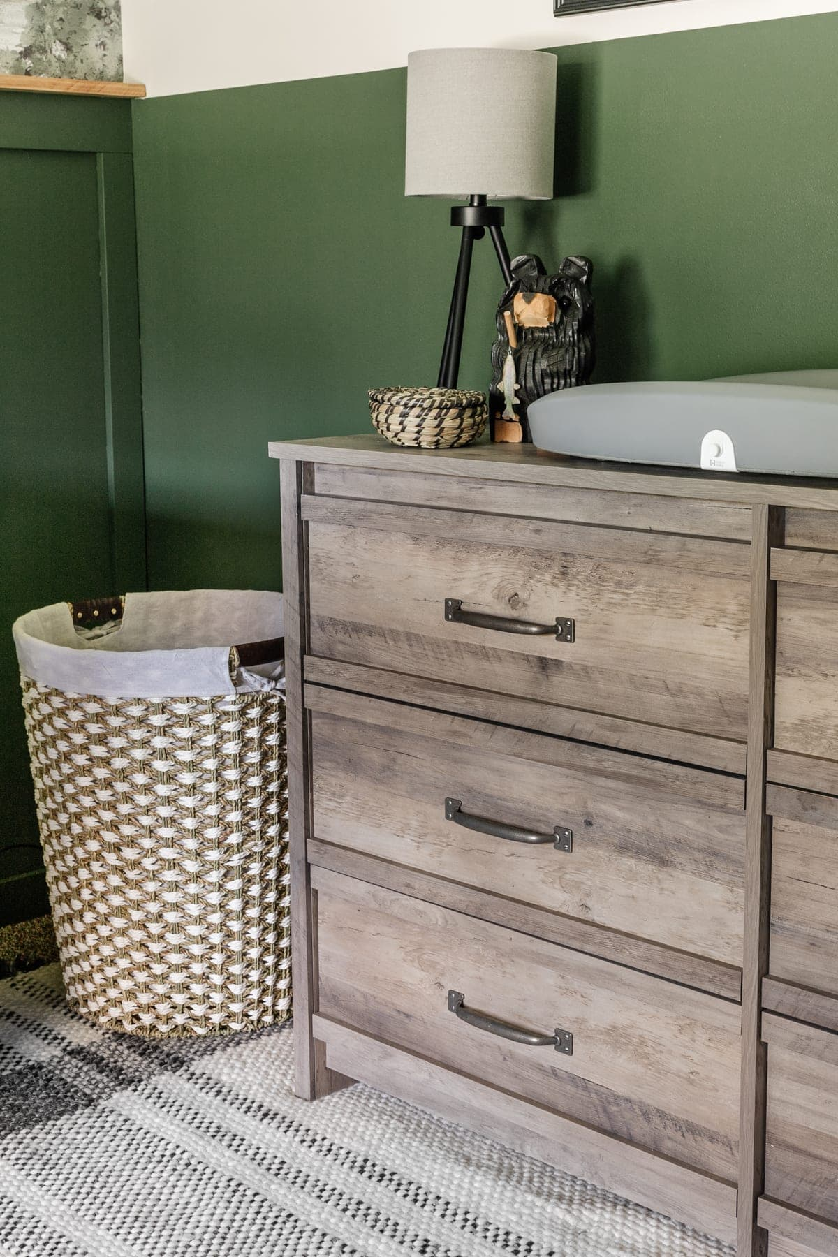 boy nursery with weathered wood dresser