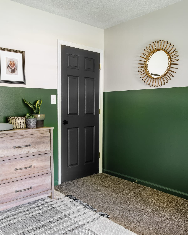 boy nursery with Romabio Midsummer green paint and black door
