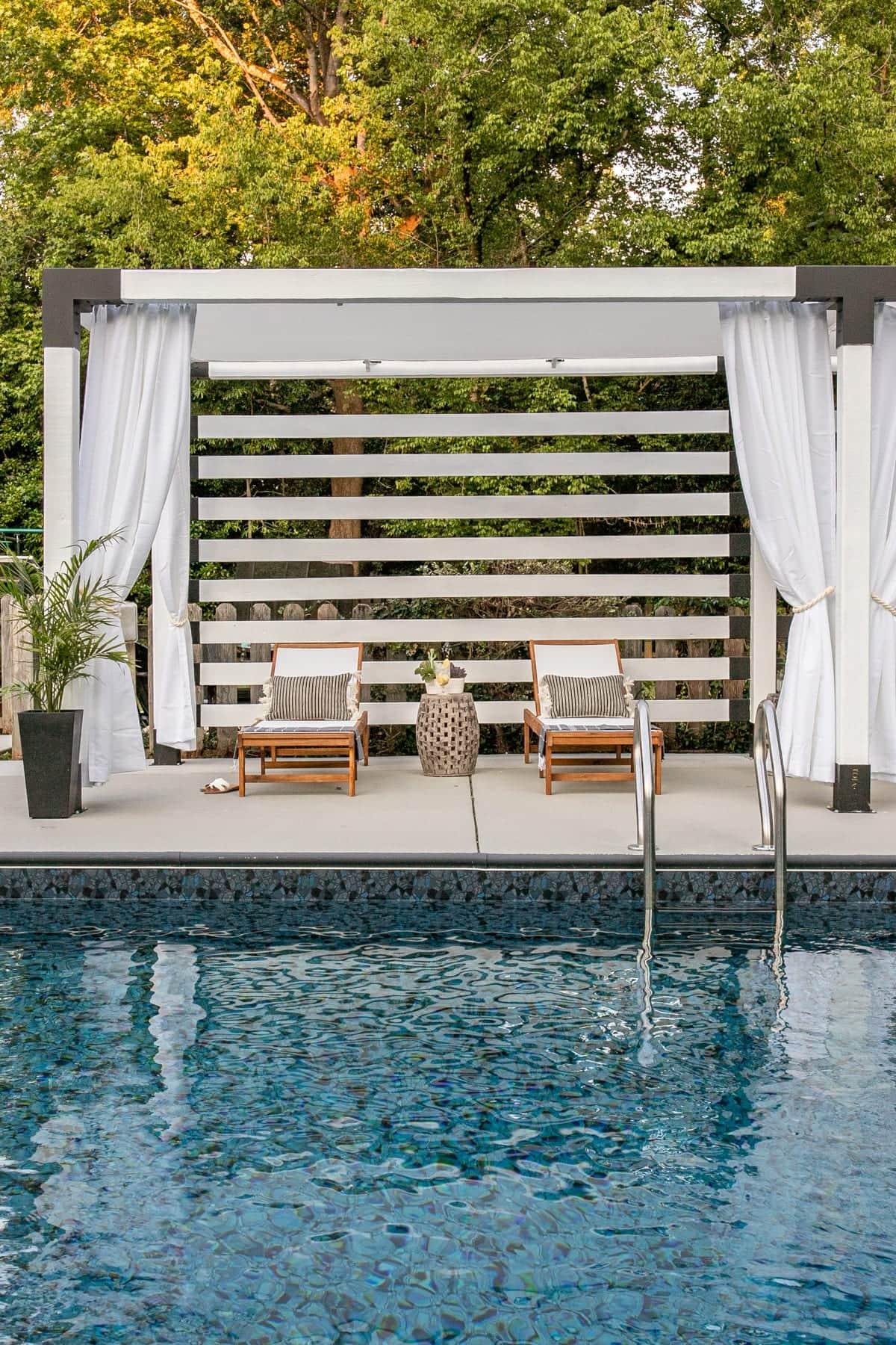 backyard pergola poolside cabana with white outdoor curtains