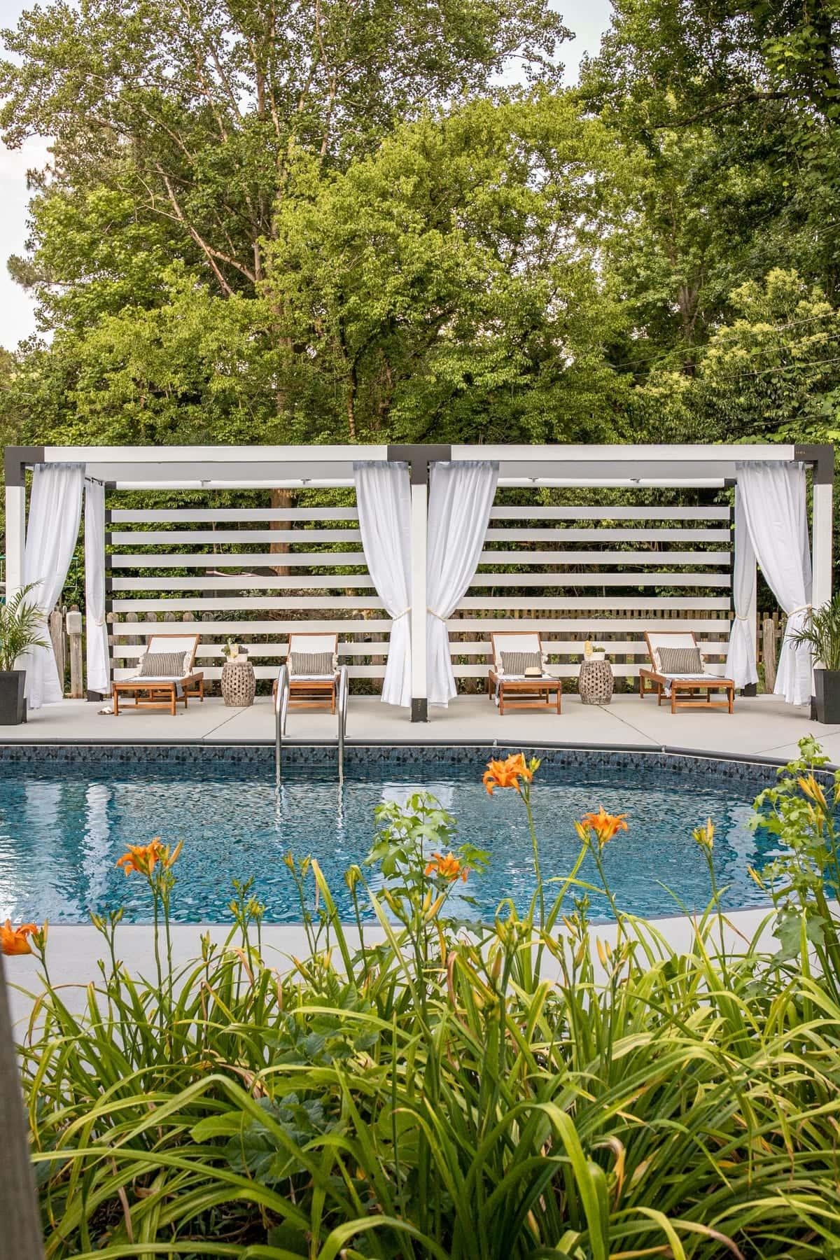 DIY cabana beside a backyard pool