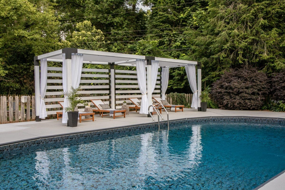 pool makeover with DIY pergola cabana and painted concrete