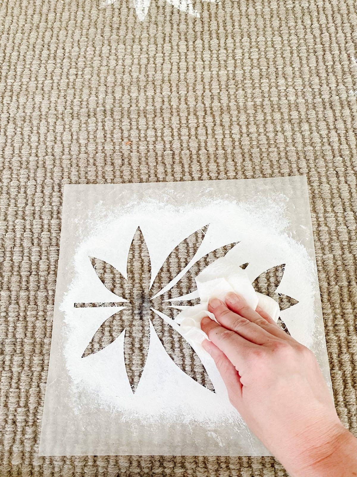 stenciling an outdoor rug with a floral block pattern