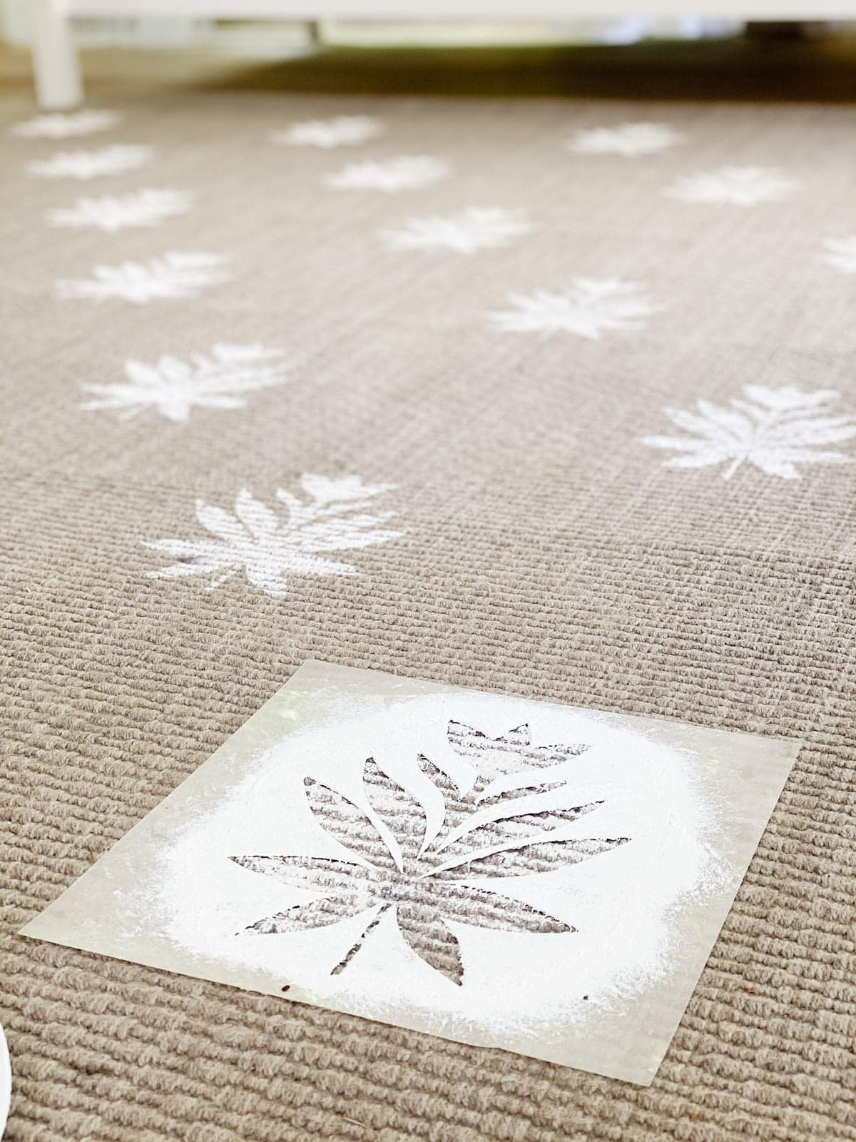 DIY outdoor rug with floral block pattern using a homemade stencil from a Cricut machine