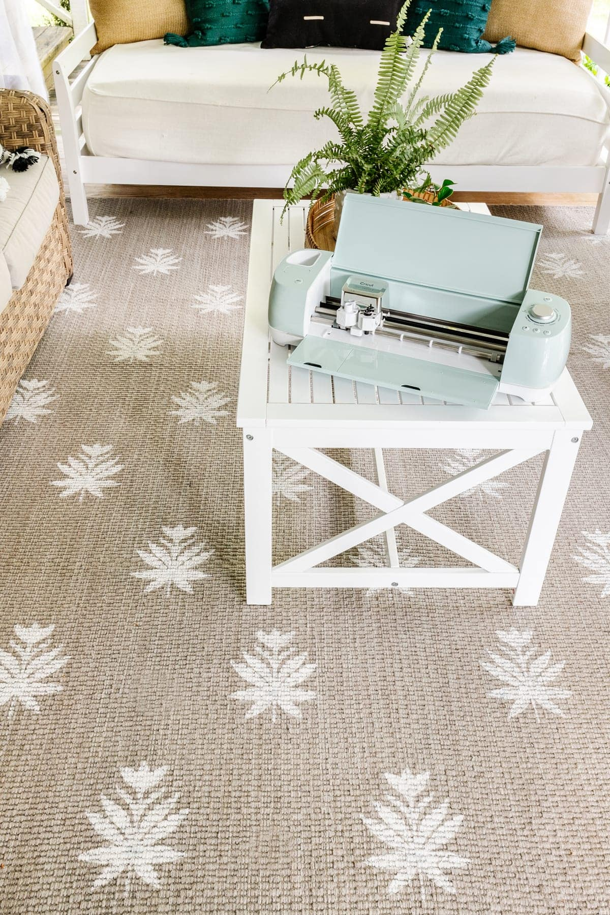 DIY outdoor rug with a floral block pattern using a stencil made from a Cricut machine