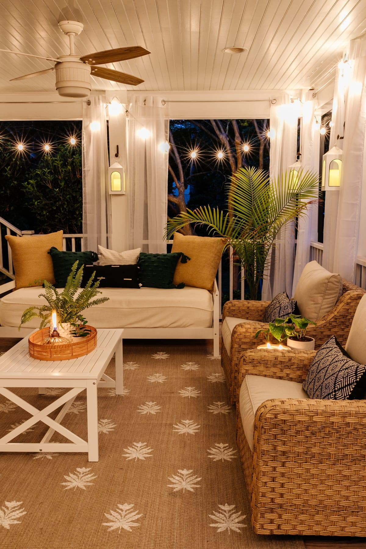 back porch at night with twinkle lights and candles