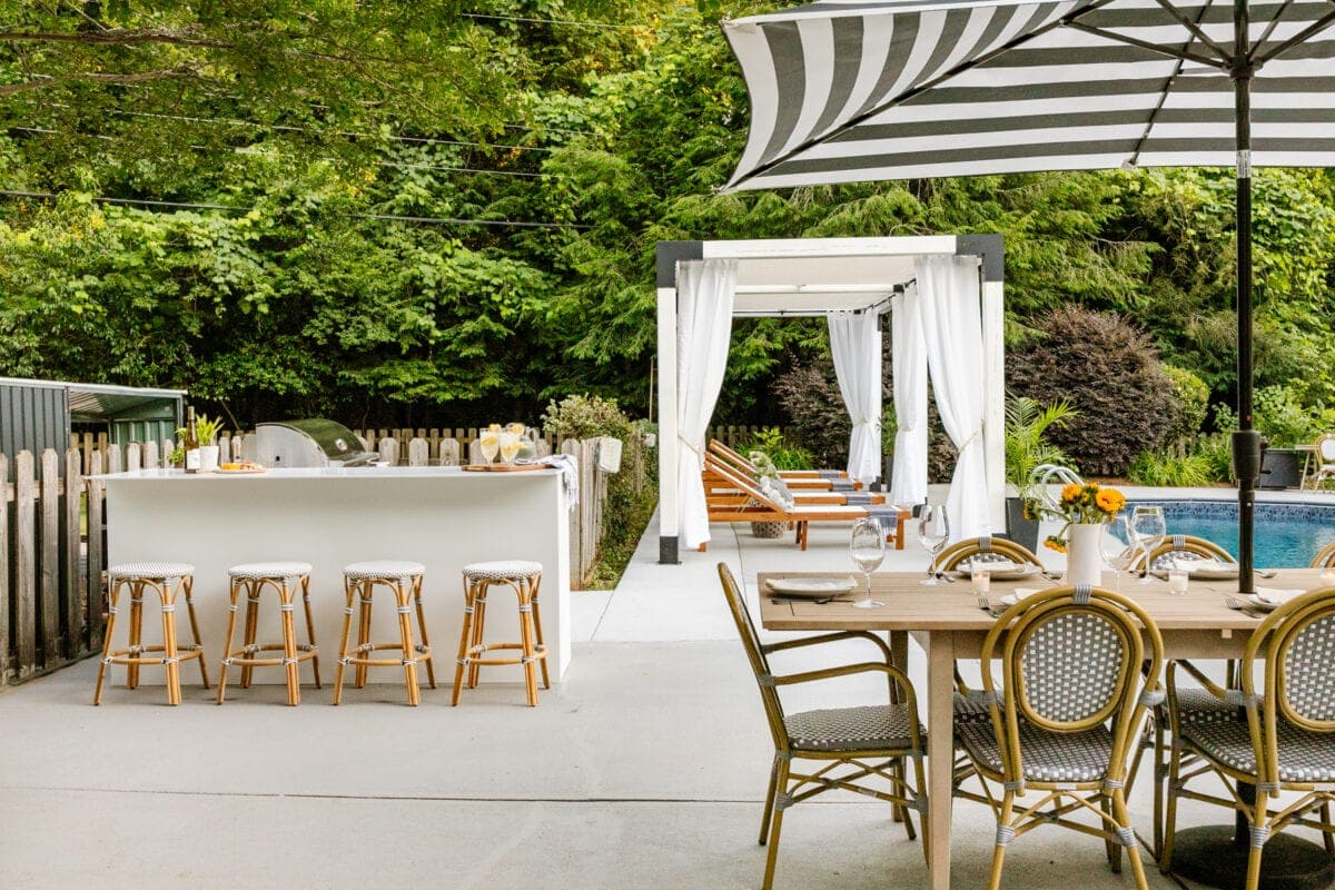 pergola cabana modular outdoor kitchen and outdoor dining table in a backyard