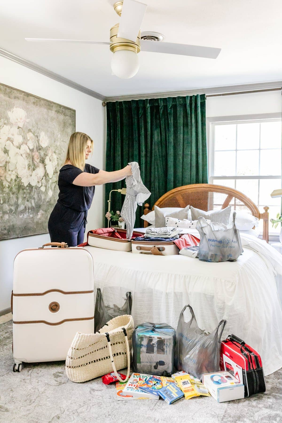 packing a suitcase with travel essentials