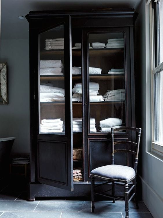 black linen cabinet with wood interior