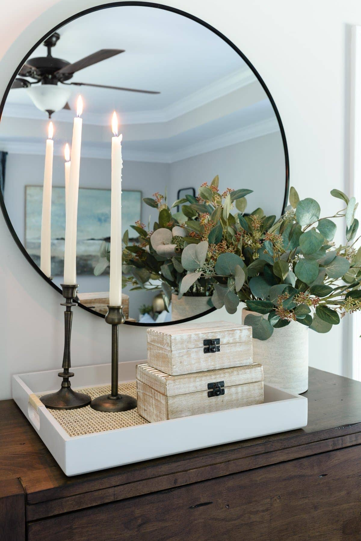 thrift store home decor featuring candle holders and decorative boxes