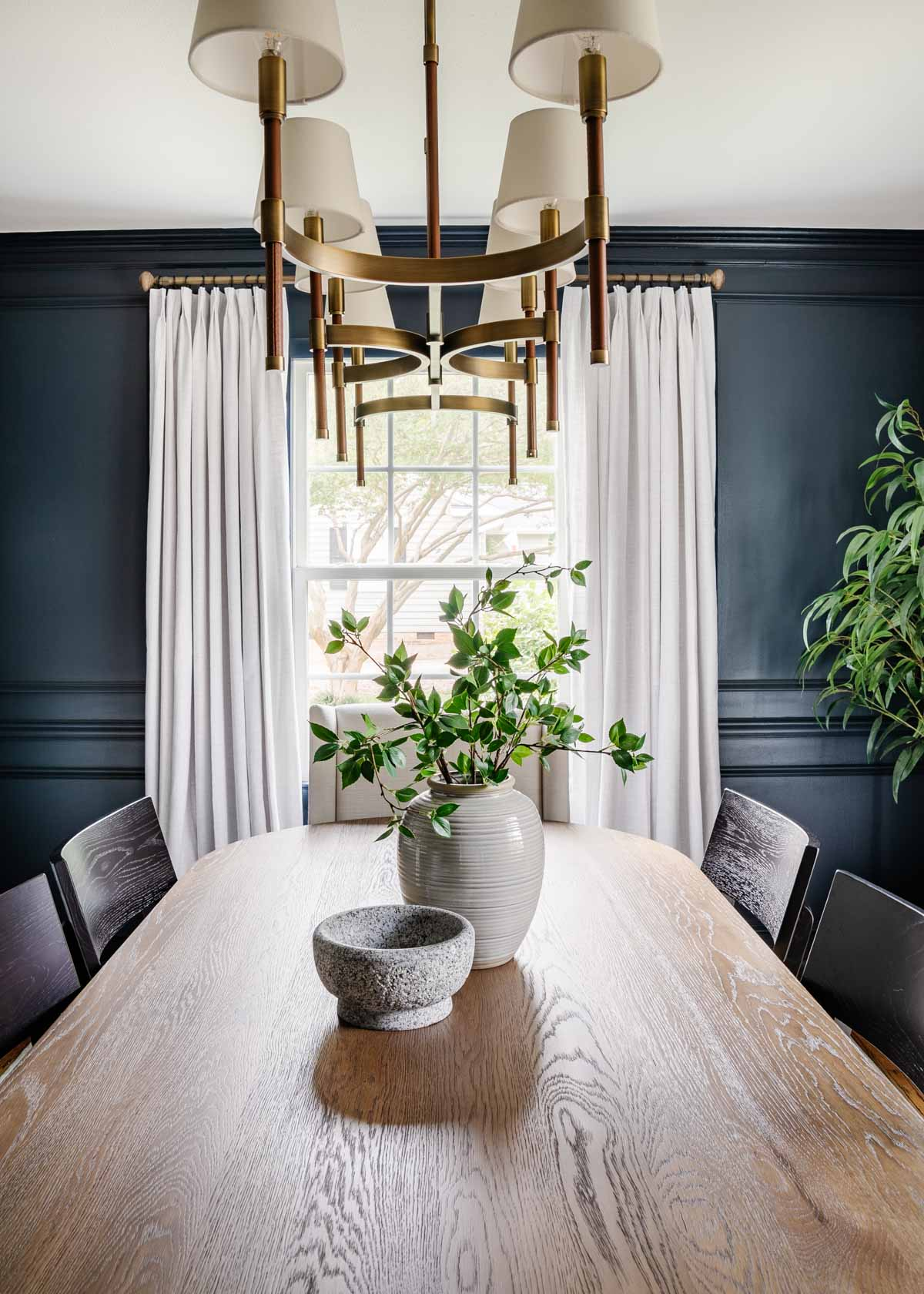 navy dining room with linen curtains